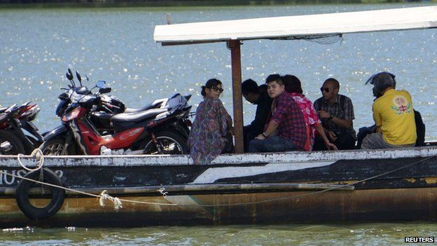 Relatives of death row prisoners ride a small ferry to at Wijayapura quay in Cilacap, Central Java