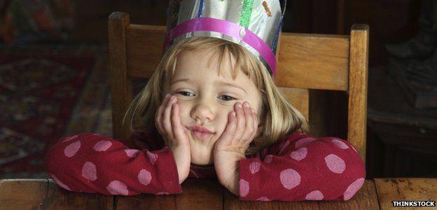 Sad child at birthday party