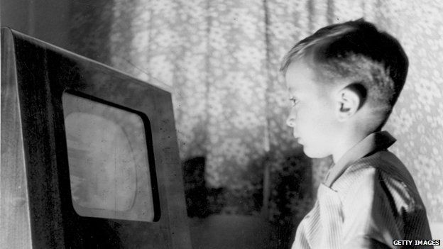 1950s boy stares at TV