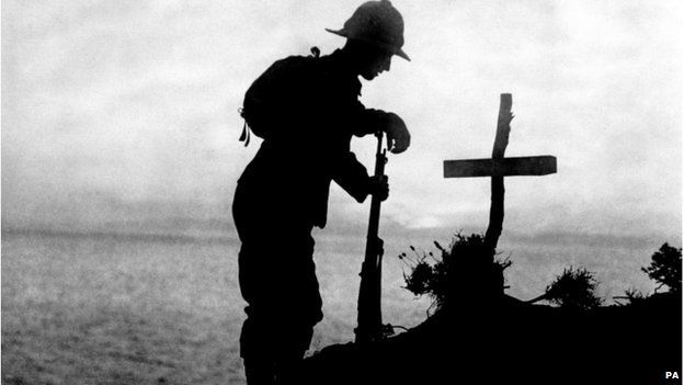 A British soldier tending a grave in Gallipoli
