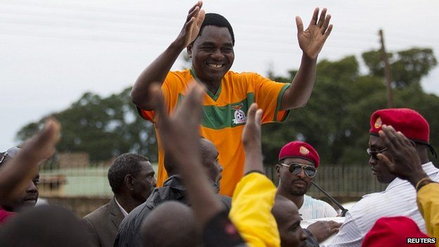 Candidate Hakainde Hichilema greets supporters as he leaves a rally in Lusaka. 18 Jan 2015