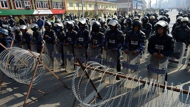 Nepalese riot police stand guard near the Constitutional Assembly building in Kathmandu during a nationwide general strike led by the Unified Communist Party of Nepal (Maoist) in Kathmandu on January 20, 2015