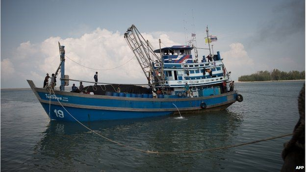 In this picture taken on 3 December 2014, Myanmar national and migrant workers on a fishing boat in Ban Nam Khaem village in Chiang Mai, Thailand.