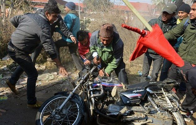 Nepalese supporters of the 30-party alliance, led by the Unified Communist Party of Nepal (Maoist), vandalise a motorcycle during a one-day nationwide general strike in Kathmandu on January 20, 2015