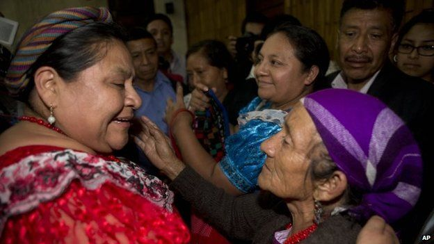 Rigoberta Menchu hugs another woman at the sentencing hearing in Guatemala City on 19 January,, 2015.