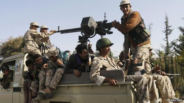 Houthi fighters patrol Sanaa, Yemen (22 January 2015)