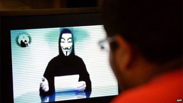 A person claiming to speak for activist hacker group Anonymous is seen issuing a warning through a video circulated online to 'go to war' with the Singapore government over recent Internet licensing rules on November 1, 2013.