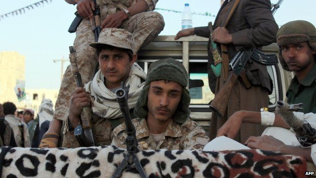 Houthi fighters in army uniform ride patrol in a pickup during a demonstration to show support for their comrades in Sanaa 23/01/2015