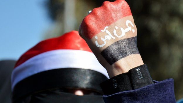 A Yemeni woman with hand painted in the colours of the Yemeni flag, the words reading in Arabic 'Yemen is safe', takes part in the demonstration in Sanaa 24/01/2015