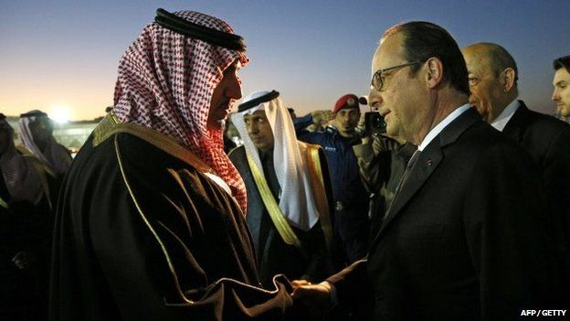 French President Francois Hollande (R) is welcomed by the Governor of the Riyadh Province, Turki bin Abdullah al-Saud (L) upon his arrival at Riyadh airport on 24 January 2015