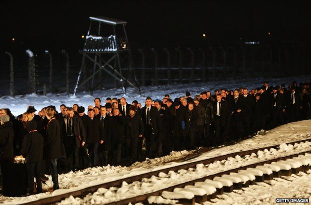 Delegations make their way to lay candles at the Birkenau Memorial, 27 January