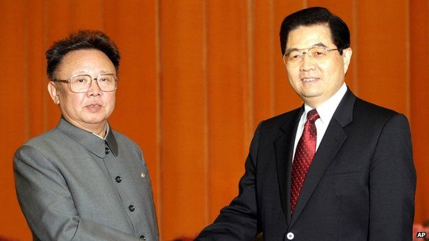 In this photo released by China's Xinhua new agency, Chinese President Hu Jintao, right, shakes hands with North Korean leader Kim Jong-il, left, at Beijing's Great Hall of the People on 17 January 2006