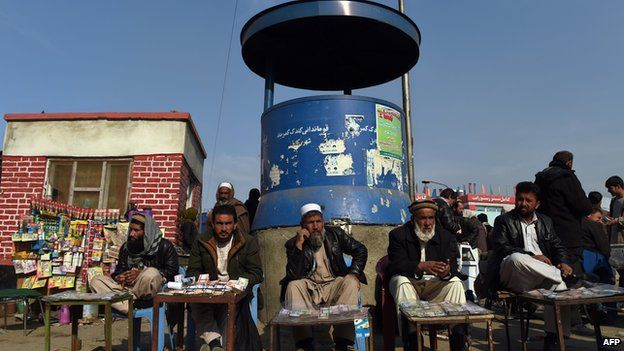 Kabul money changers waiting for customers 29 Dec 2014