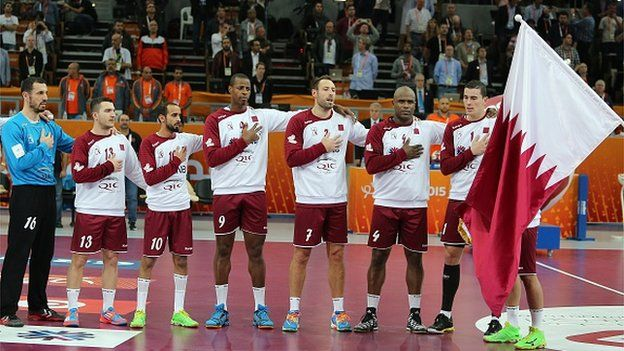 Players for the Qatar team stand at attention for the national anthem before the 24th Men's Handball World Championships quarterfinals match between Germany and Qatar at the Lusail Multipurpose Hall in Doha on January 28