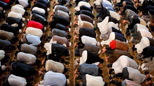 Men praying in a London mosque