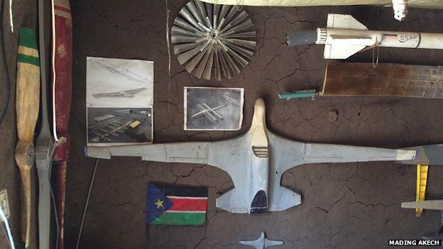 Model aircraft on the wall of George Mel's bedroom/study
