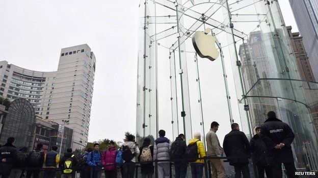 Customers queue to wait for the opening of a new Apple Store in Chongqing municipality 31 January 2015