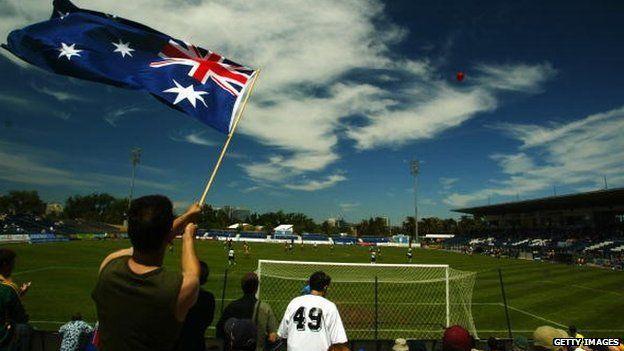 An Australian fan waves the national flag during the U/20 International between Australia and Fiji at Bob Jane Stadium in Melbourne, Australia on December 21, 2002