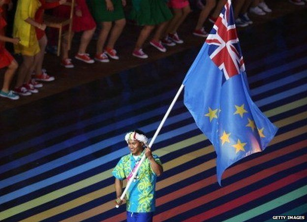 Flag bearer and Weightlifter Lapua Lapua of Tuvalu during the Opening Ceremony for the Glasgow 2014 Commonwealth Games at Celtic Park on July 23, 2014 in Glasgow, Scotland