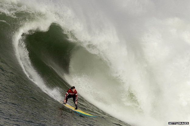 Colin Dwyer rides a wave during the Mavericks Invitational on January 24, 2014 in Half Moon Bay, California.