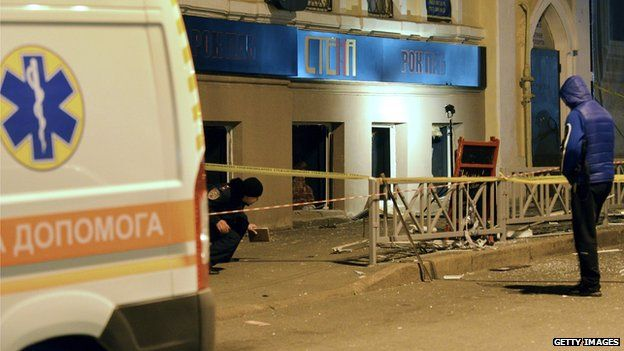 Police experts search for evidence after an explosion in a pub
