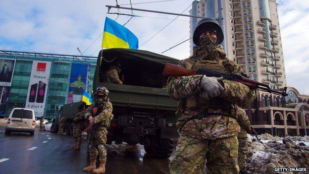 Soldiers with machine guns on patrol in Odessa