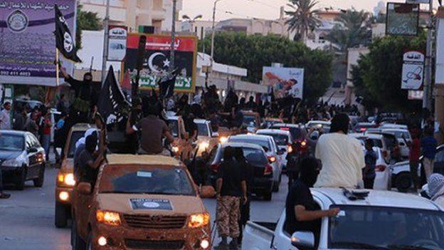 Islamic State militants parading through Derna