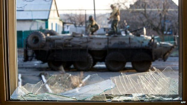 Ukrainian soldiers stand on a military vehicle in the village of Horlivka, Donetsk region - 4 February 2015