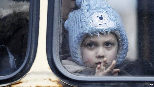 A child waits on a bus to leave the town of Debaltseve, Ukraine, 3 February 2015