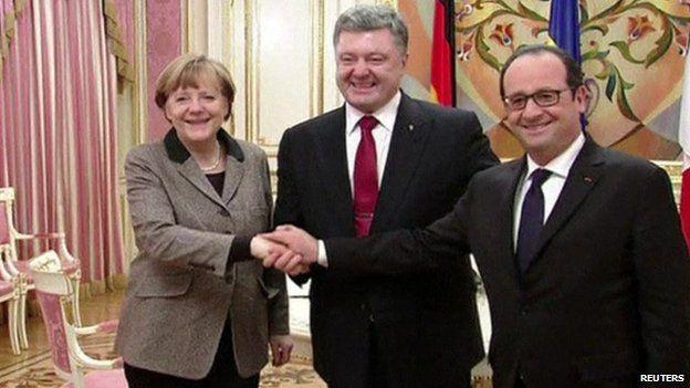 German Chancellor Angela Merkel, Ukrainian President Petro Poroshenko and French President Francois Hollande shaking hands in Kiev, Ukraine, 5 February 2015