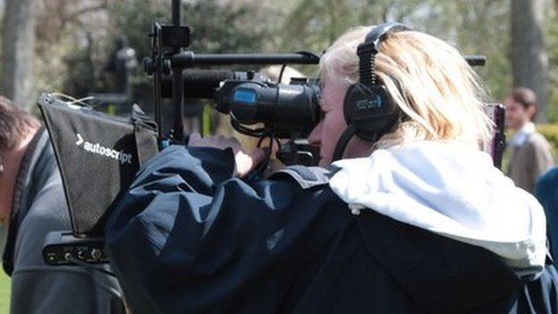 TV camera being operated by a camerawoman