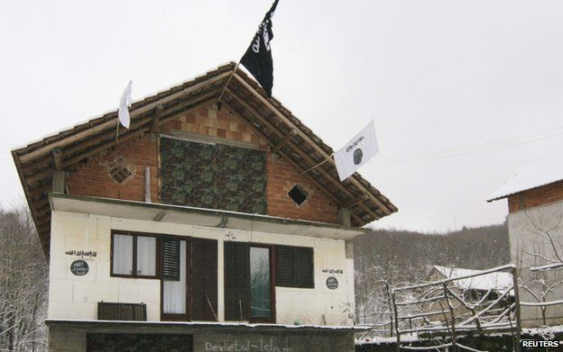 A house in the Bosnian village of Gornja Maoca decorated with Islamic State flags, January 26, 2015