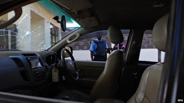Bullet holes are seen on the wind screen of the vehicle of a Kenyan Member of Parliament (MP) George Muchai