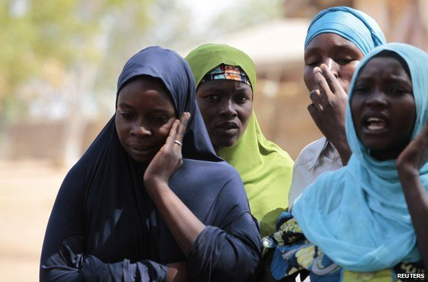 Women who escaped a 2014 Boko Haram attack in Nigeria's Adamawa state at a camp for displaced people, 31 January