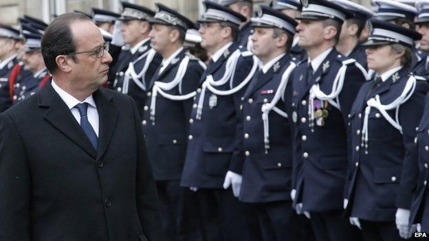 French President Francois Hollande reviews Police officers troops during a ceremony to pay tribute to the three police officers killed in the attacks, in Paris, France, 13 January 2015