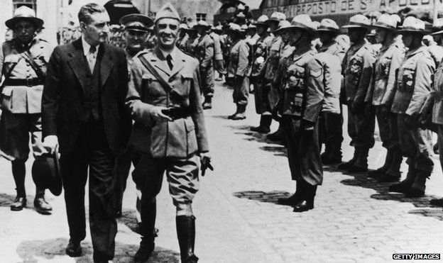 Portuguese dictator Antonio De Oliveira Salazar reviews troops about to embark for the African colonies in 1950