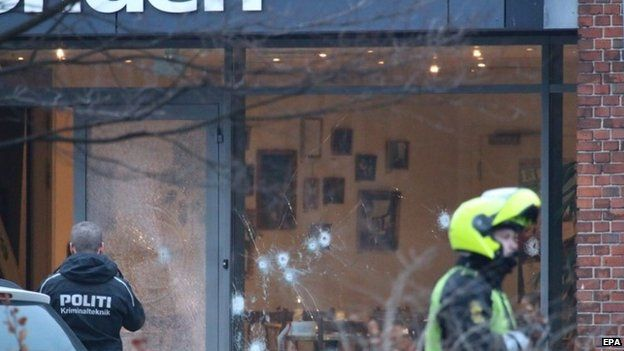 Bullet holes are seen in the window and door of Krudttonden cafe after shots were reportedly fired during a discussion meeting about art, blasphemy and free speech in Copenhagen, Denmark, 14 February 2015