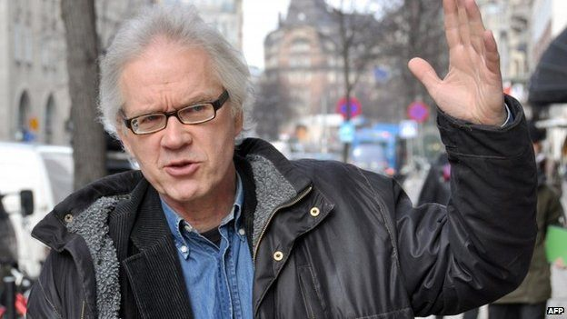 A photo taken on March, 11, 2010 shows Swedish cartoonist Lars Vilks walking in the streets of Stockholm. Vilks, known for his drawing of the Prophet Mohammed with the body of a dog in 2007 was attending a debate on Islam and free speech as gunmen opened fire on February 16, 2015 in Copenhagen