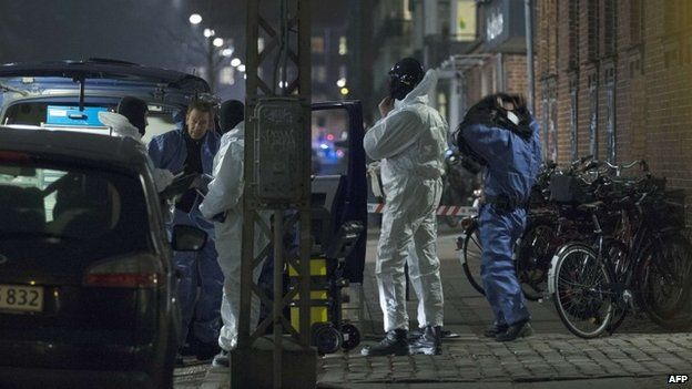 Forensic police officers work at the area around a cultural centre in Copenhagen, Denmark, where shots were fired during a debate on Islam and free speech on February 14, 2015