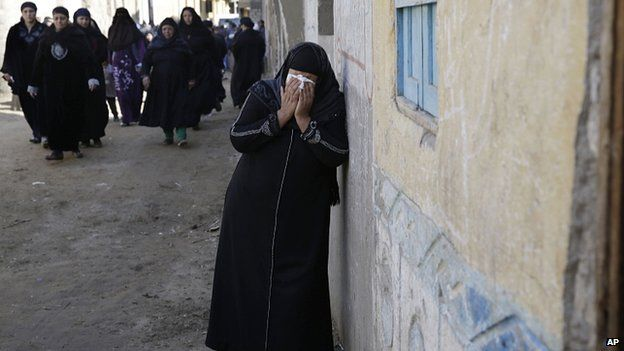 Relatives of Egyptian Coptic Christian workers mourn in Al-Our. 15 February 2015