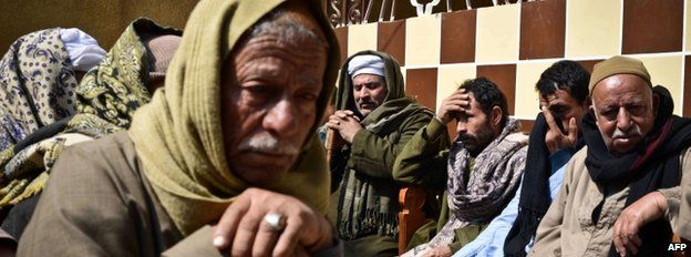 Relatives of Egyptian Coptic Christian workers mourn. 15 February 2015