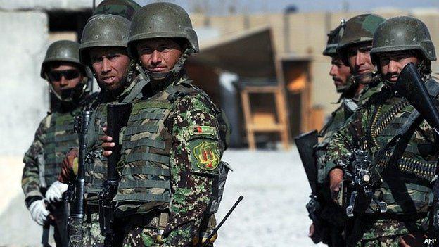 Afghan soldiers on foot patrol on 10 December 2014