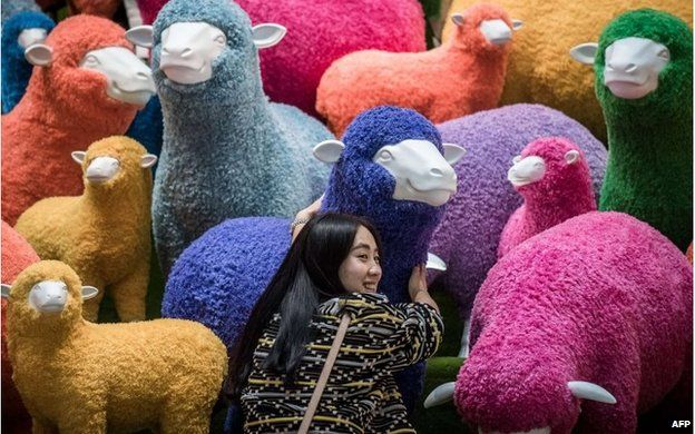 Woman with sheep display in Hong Kong (18 Feb 2015)