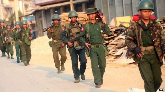 Myanmar soldiers patrol in Laukkai, the main city in the Kokang region of northern Myanmar Shan state, on February 16, 201