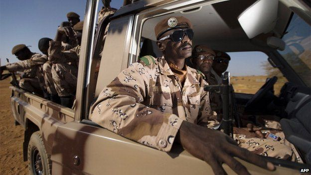 Malian soldiers sit in a vehicle on December 31, 2013 at the French military base in Gao, northern Mali.