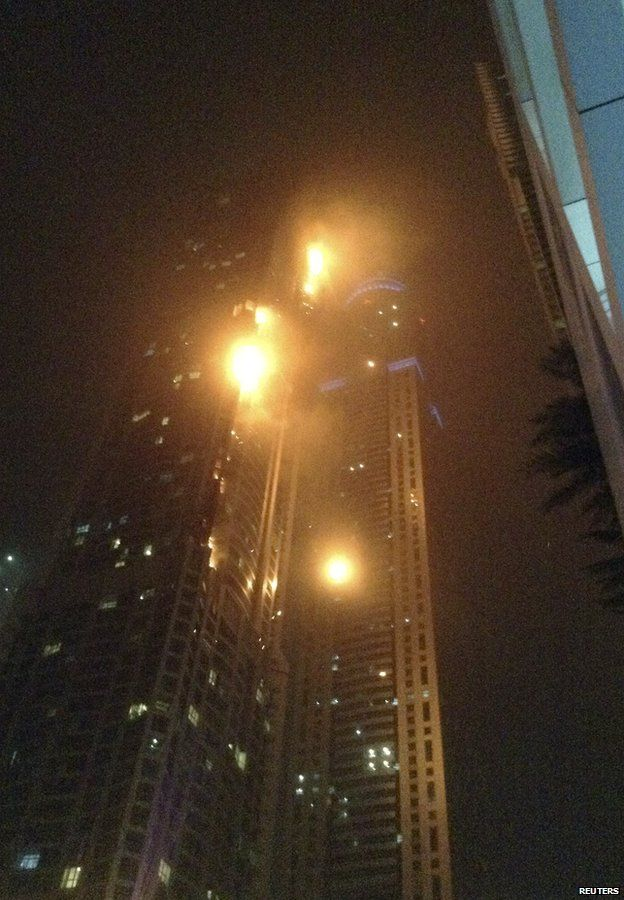 """A fire blazes at """"The Torch"""", a residential high-rise tower, in Dubai February 21, 2015"""