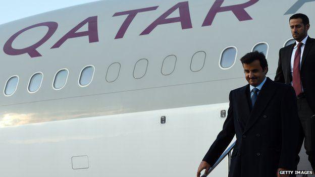 Emir Sheikh Tamim bin Hamad Al Thani (left), arriving in Tokyo