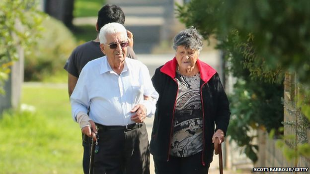 An elderly couple walk down the street on May 13, 2014 in Melbourne, Australia.