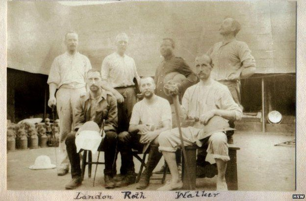 Captain Walker, seated, on the right, in Benin City after British troops looted the palace