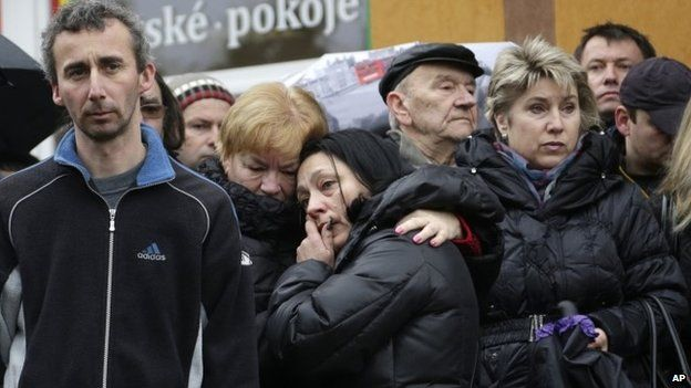 Residents pay respect to victims of a shooting in Uhersky Brod, Czech Republic, Wednesday, Feb. 25, 2015.
